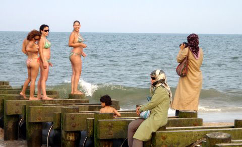 muslim woman takes pic of mermaids