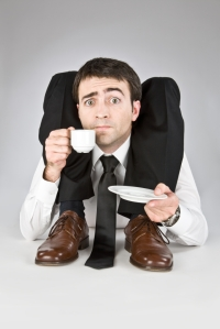 contortion business manager drinking coffee