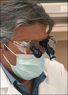 Dentist wearing loupes