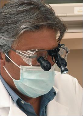 Dentist wearing loupes